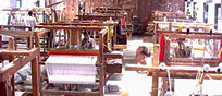 People working on handlooms