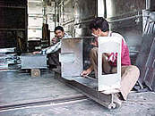 Workers in a Sheet Metal Industry - kullu Valley